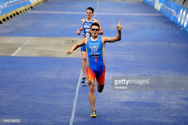In this handout photo released by the International Triathlon Union Javier Gomez of Spain reacts as he wins the Grand Final of the 2012 ITU World...