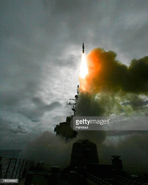 In this handout photo released by the Japan Maritime Self Defense Force a Standard Missile 3 is launched from the Japan Maritime Self Defense Force...