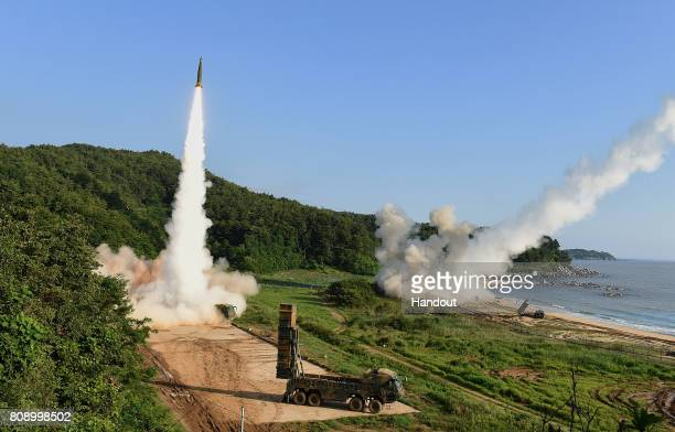In this handout photo released by the South Korean Defense Ministry South Korea's Hyunmu2 Missile System and US M270 Multiple Launch Rocket System...
