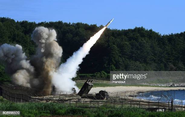 In this handout photo released by the South Korean Defense Ministry US M270 Multiple Launch Rocket System firing an MGM140 Army Tactical Missile...