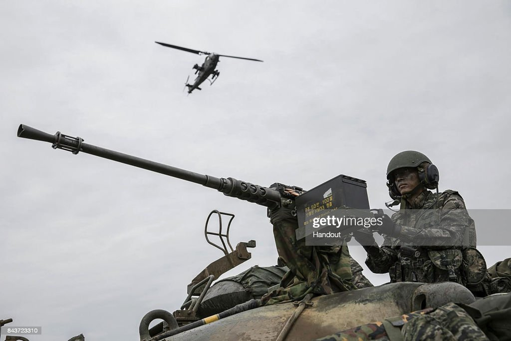 In this handout photo released by the South Korean Defense Ministry, South Korean marines participate in an exercise on September 6, 2017 in Baengnyeong Island, South Korea. The exercise aims to defend a front-line island.