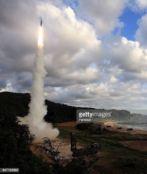 In this handout photo released by the South Korean Defense Ministry South Korea's missile system firing Hyunmu2 firing a missile into the East Sea...