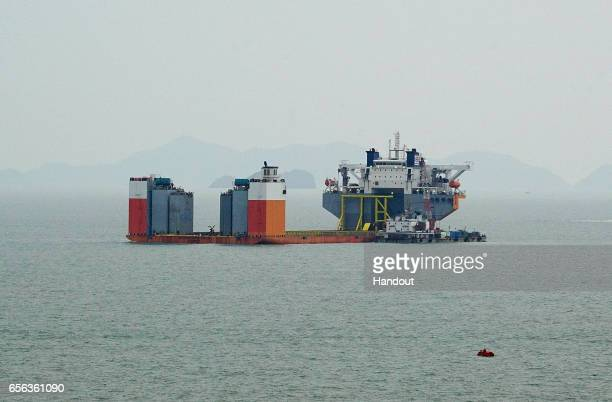 In this handout photo released by the South Korean Maritime Ministry a submersible vessel attempts to salvage sunken Sewol ferry in waters off Jindo...