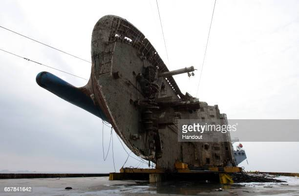 In this handout photo released by the South Korean Ministry of Oceans and Fisheries The sunken Sewol ferry on a semisubmersible transport vessel...