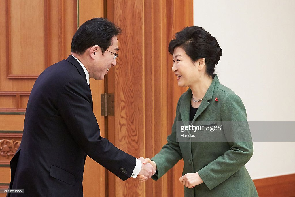 In this handout photo released by the South Korean Presidential Blue House, South Korea's President Park Geun-Hye (R) shakes hands with Japanese Foreign Minister Fumio Kishida (L) before their meeting at the presidential blue house on December 28, 2015 in Seoul, South Korea. South Korean Foreign Minister Yun Byung Se and Japanese Foreign Minister Fumio Kishida met to discuss the issue of Korean 'comfort women' in Japanese military brothels before and during World War II.