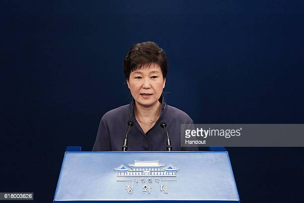 In this handout photo released by the South Korean Presidential Blue House, South Korea's President Park Geun-Hye speaks as she offers a public...