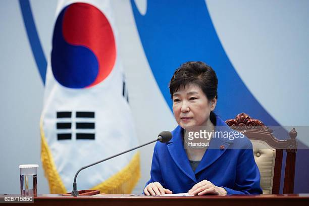 In this handout photo released by the South Korean Presidential Blue House, South Korea's President Park Geun-Hye attends the emergency cabinet...