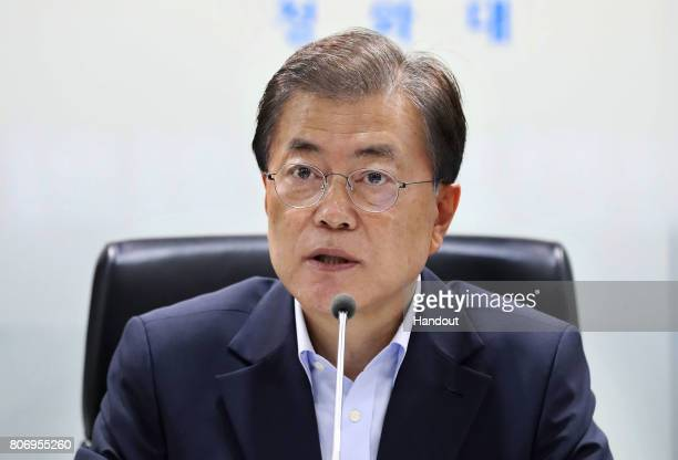 In this handout photo released by the South Korean Presidential Blue House, South Korean President Moon Jae-in speaks as he presides over a meeting...