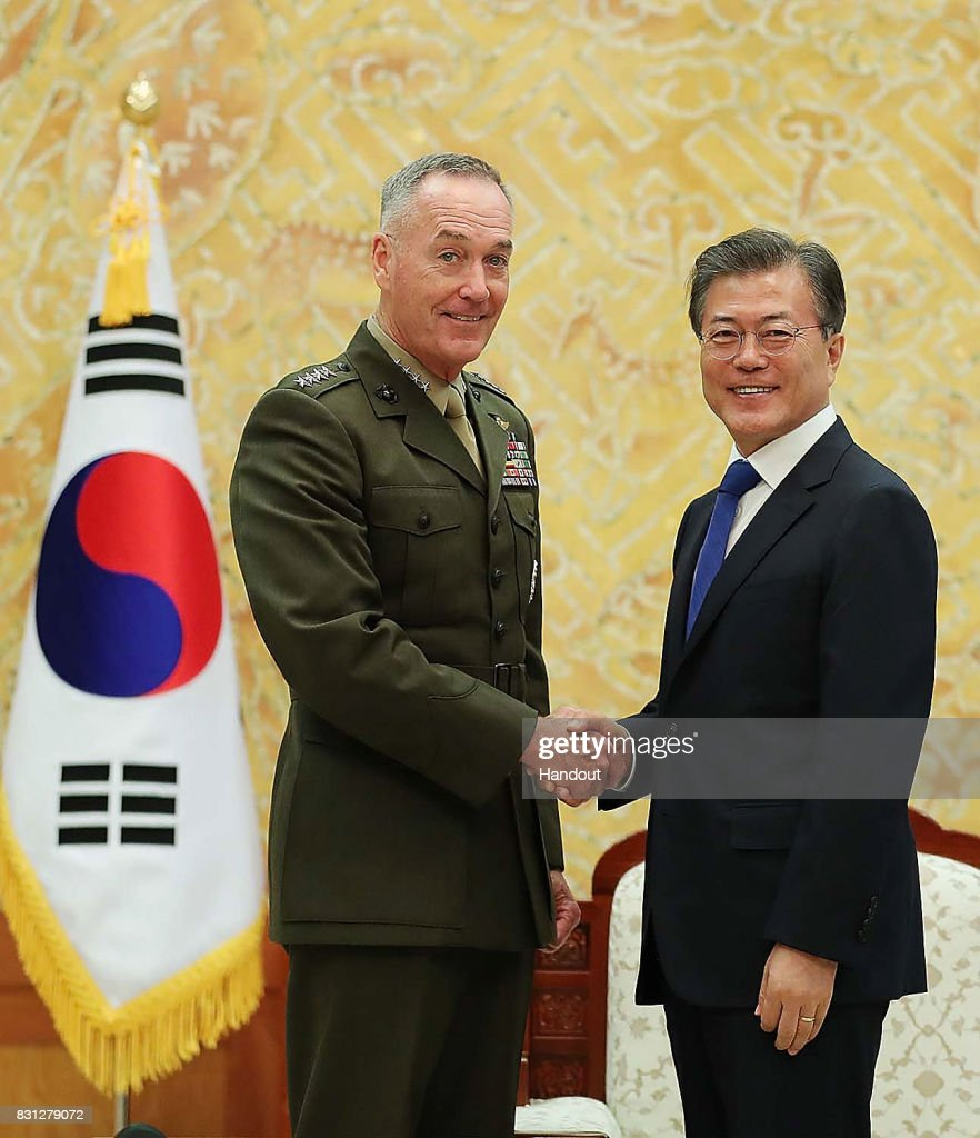 In this handout photo released by the South Korean Presidential Blue House, South Korean President Moon Jae-in (R) shakes hands with U.S. Chairman of the Joint Chiefs of Staff Gen. Joseph Dunford (L) before their meeting at the presidential Blue House on August 14, 2017 in Seoul, South Korea. Dunford is in South Korea to discuss the North Korean nuclear and missile threats with South Korea's defense minister and the military chief.