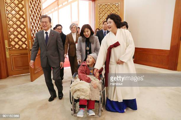 In this handout photo released by the South Korean Presidential Blue House South Korean President Moon Jaein meets 'comfort women' former South...