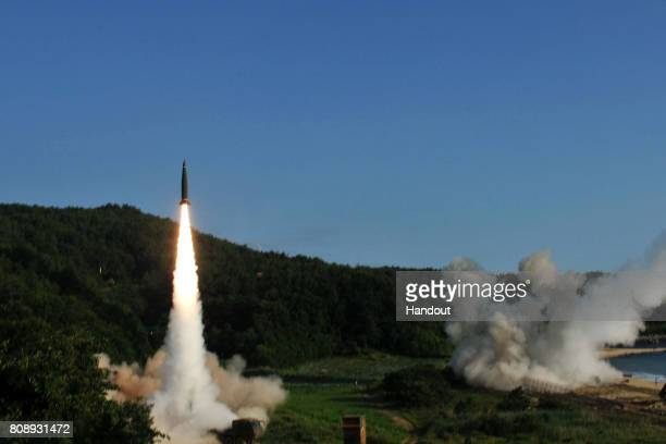 In this handout photo released by the United States Forces Korea South Korea's Hyunmu2 Missile System firing a tactical ballistic missile during a US...