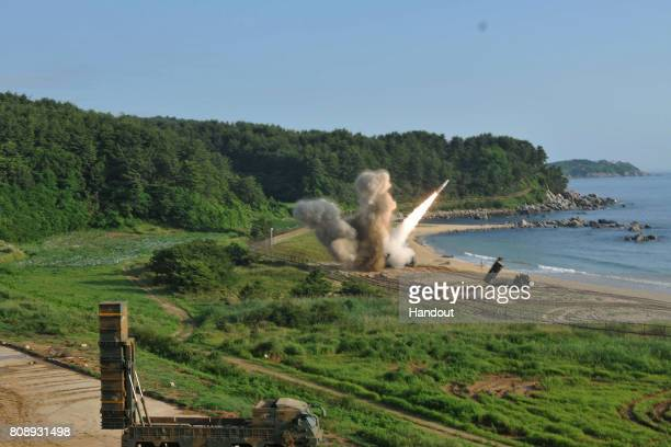 In this handout photo released by the United States Forces Korea US M270 Multiple Launch Rocket System firing an MGM140 Army Tactical Missile during...