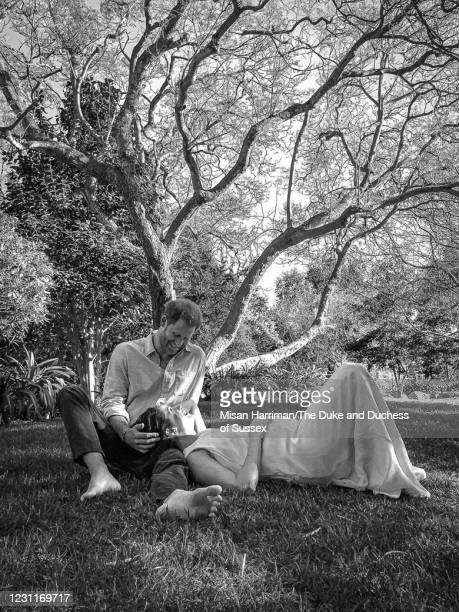 In this handout photo released on February 14 Prince Harry, Duke of Sussex and Meghan, Duchess of Sussex are photographed sitting together in the...