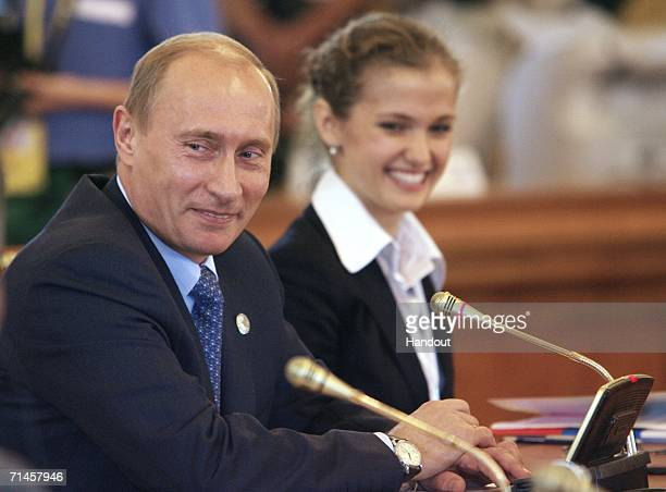 In this handout photo Russian President Vladimir Putin meets with eight youth delegates from G8 member countries on July 16 2006 in St Petersberg...