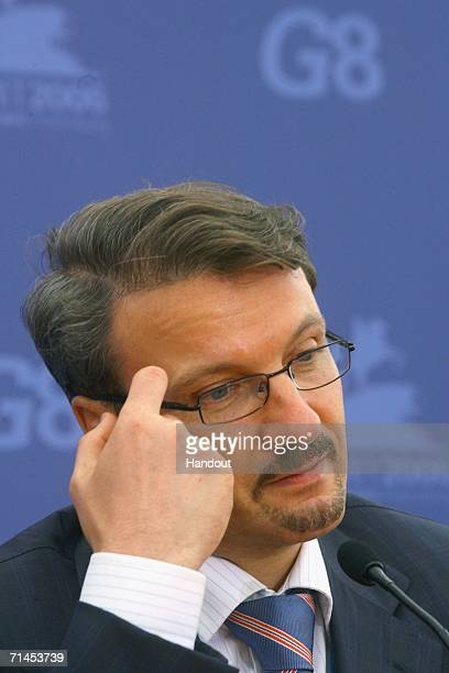 In this handout photo, Russian Trade and Economic Development Minister German Gref prepares to speak during a news briefing at the International...