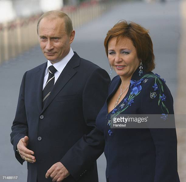 In this handout photo Russia's President Vladimir Putin and his wife Lyudmila Putina await G8 leaders to attend an informal dinner of the G8 leaders...