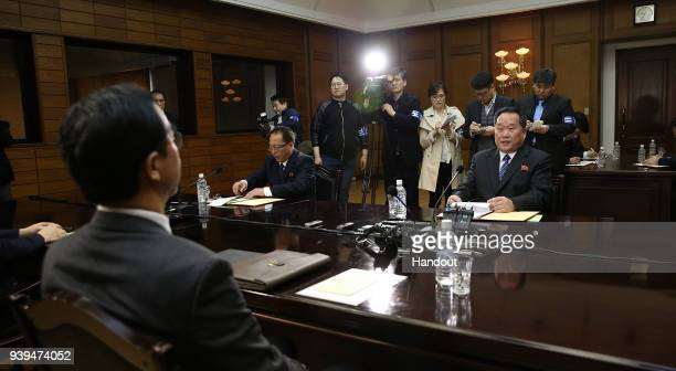 In this handout photo South Korean Unification Minister Cho MyoungGyon talks with North Korean delegation head Ri SonGwon during their meeting on...