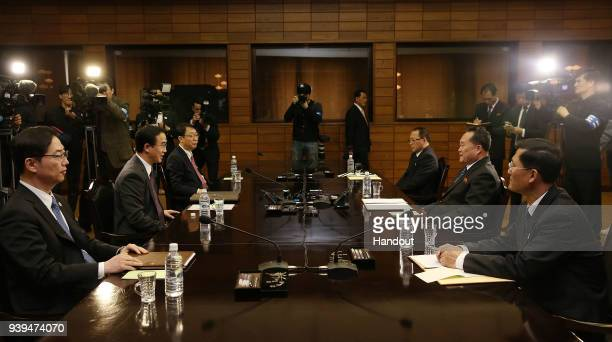 In this handout photo South Korean Unification Minister Cho MyoungGyon talks with North Korean delegation head Ri SonGwon before their meeting on...