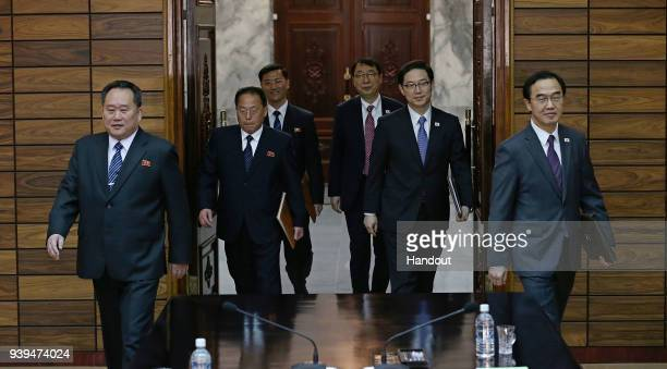 In this handout photo South Korean Unification Minister Cho MyoungGyon walks with North Korean delegation head Ri SonGwon before their meeting on...