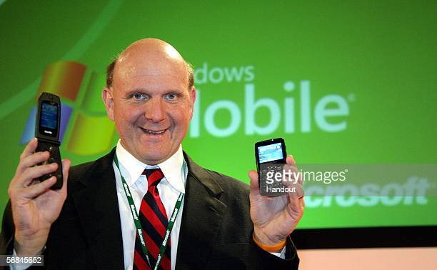 In this handout photo Steve Ballmer Chief Executive Officer of the Microsoft Corporation holds the Samsung imate Smart Flip and SGHi320 during the...