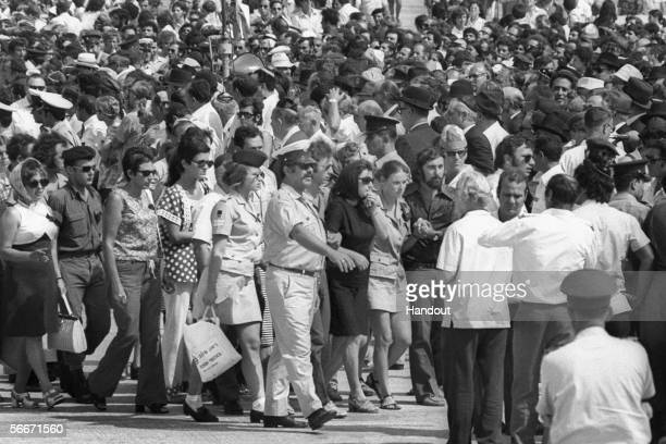 In this handout photo supplied by GPO, grieving relatives of the 11 Israeli athletes murdered by Palestinian gunmen in the Munich Olympics arrive to...