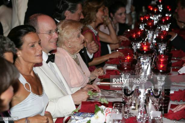 In this handout photo supplied by Realis/SBM Princess Stephanie of Monaco and Prince Albert II of Monaco attend the 59th Red Cross Ball on July 27...