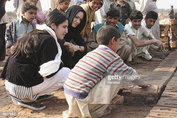 In this handout photo supplied by the United Nations High Commission for Refugees UNHCR Goodwill Ambassador Angelina Jolie visits a brick kiln on the...