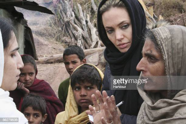 In this handout photo supplied by the United Nations High Commission for Refugees UNHCR Goodwill Ambassador Angelina Jolie listens as a local woman...