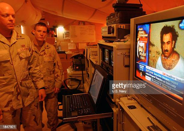 In this handout photo, U.S. Army Soldiers from the 4th Psychological Operations Group monitor CNN on their Product Distribution System March 3, 2003...