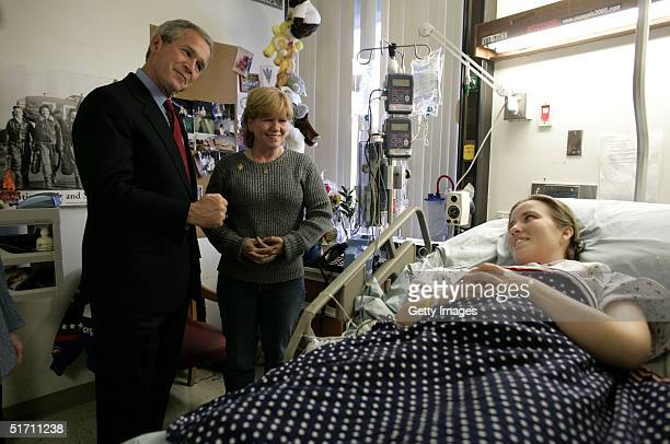 In this handout photo US President George W Bush greets US Army Sgt Carla Best of Virginia Beach Va and her mother Vickie Ebeling during a visit to...