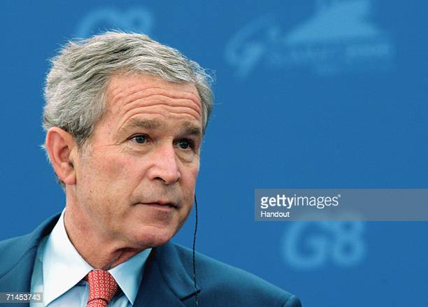 In this handout photo U.S. President George W. Bush listens during a joint news conference with Russian President Vladimir Putin at the International...
