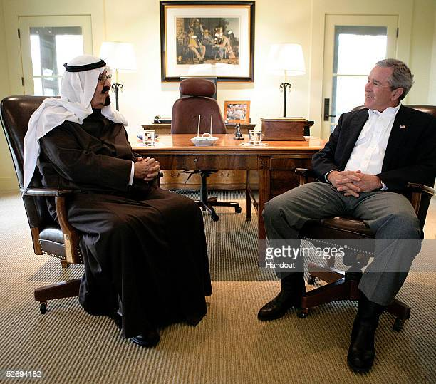 In this handout photo US President George W Bush talks to Saudi Crown Prince Abdullah during a visit to Bush's ranch April 25 2005 in Crawford Texas...