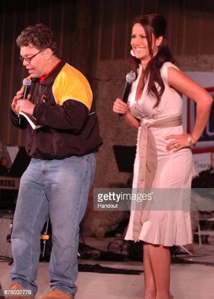 In this handout photofrom 2006 provided by the US Army Comedian Al Franken and sports commentator Leeann Tweeden perform a comic skit on camp...
