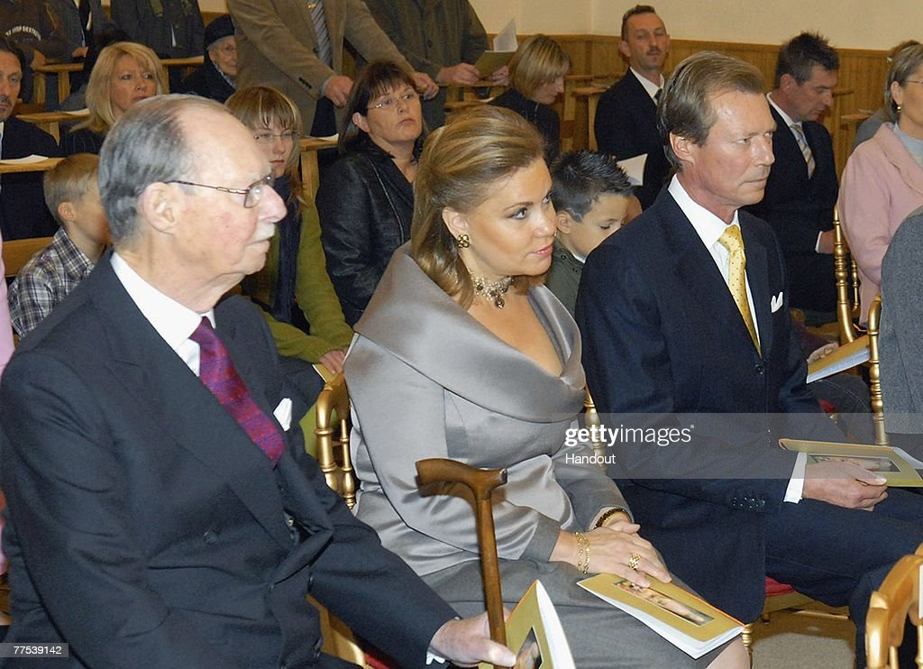 In this handout photograph issued on October 27, (L to R) Grand Duke Jean of Luxembourg, Grand Duchess Maria Teresa of Luxembourg and Grand Duke Henri of Luxembourg attend the christening of Prince Noah of Nassau in the Gilsdorf Chuch on October 27, 2007 in Luxembourg.