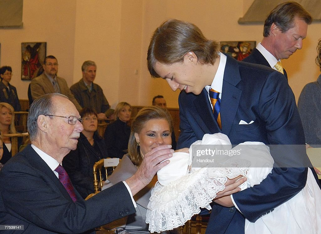 In this handout photograph issued on October 27, Prince Louis of Luxembourg presents his son Prince Noah of Nassau to Grand Duke Jean of Luxembourg (L) during the Prince Noah of Nassau's christening in the Gilsdorf Chuch on October 27, 2007 in Luxembourg.