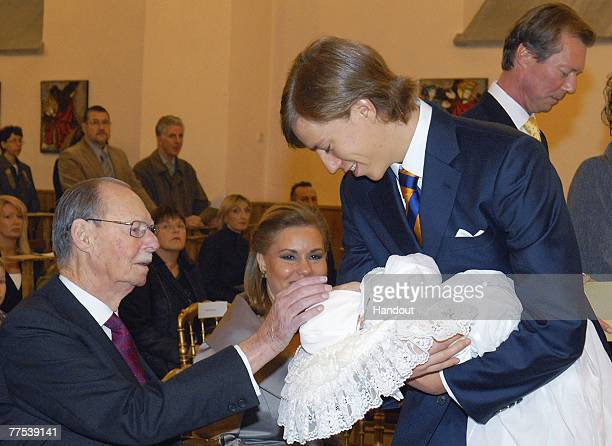 In this handout photograph issued on October 27 Prince Louis of Luxembourg presents his son Prince Noah of Nassau to Grand Duke Jean of Luxembourg...