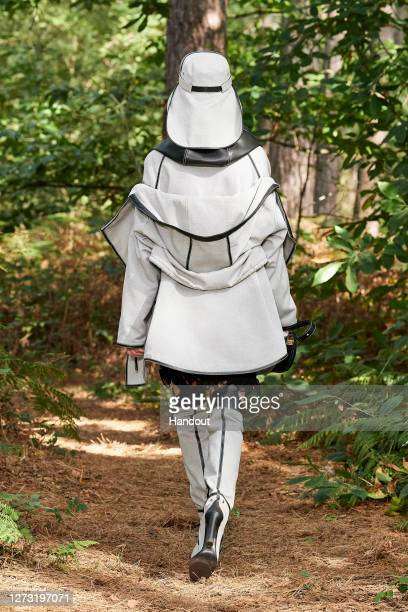 In this handout photograph provided by Burberry, a model walks the runway during the Burberry Spring/Summer 2021 show during LFW September 2020 on...