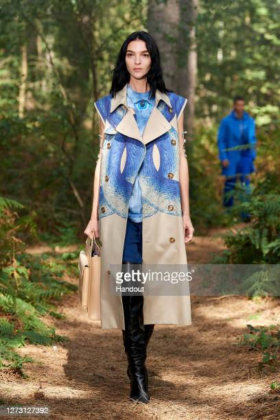 In this handout photograph provided by Burberry, model Mariacarla Boscono walks the runway during the Burberry Spring/Summer 2021 show during LFW...