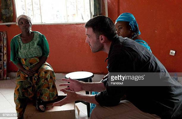 In this handout photograph provided by HEAL Africa, Ben Affleck , Founder of the Eastern Congo Initiative, meets with community-based healthcare...
