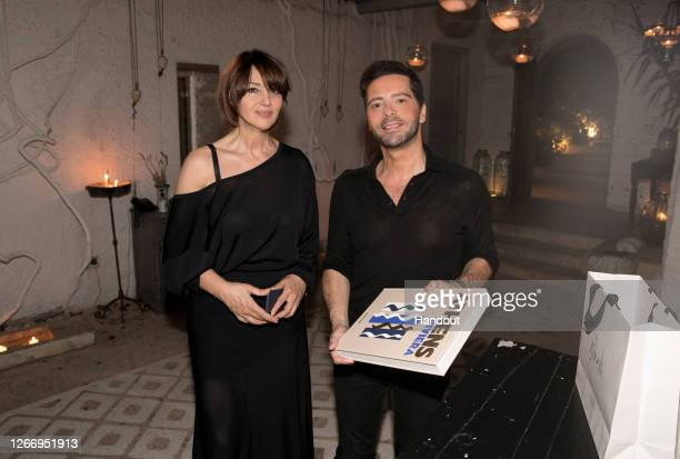 In this handout photograph provided by Panas Group Monica Bellucci and Chrysanthos Panas during her visit to Athens for her first rehearsal as she...