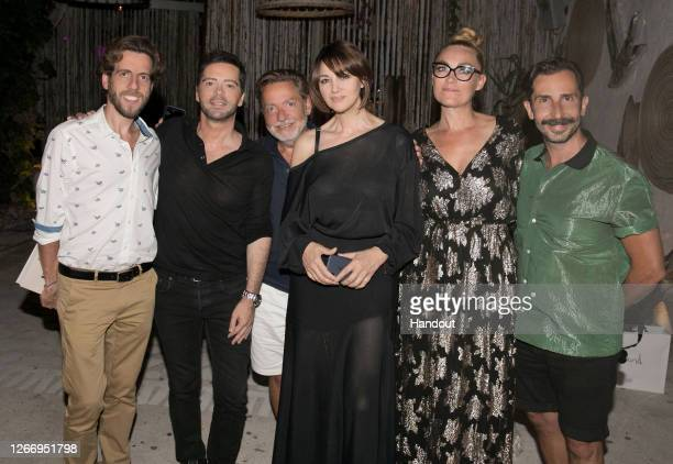 In this handout photograph provided by Panas Group Tom Volf Chrysanthos Panas Olivier Gluzman Monica Bellucci Sylvie Le Merrer and Polydoros...