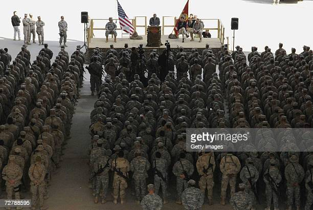 In this handout photograph provided by the Defense Department outgoing US Defense Secretary Donald Rumsfeld addresses service members at a Town Hall...