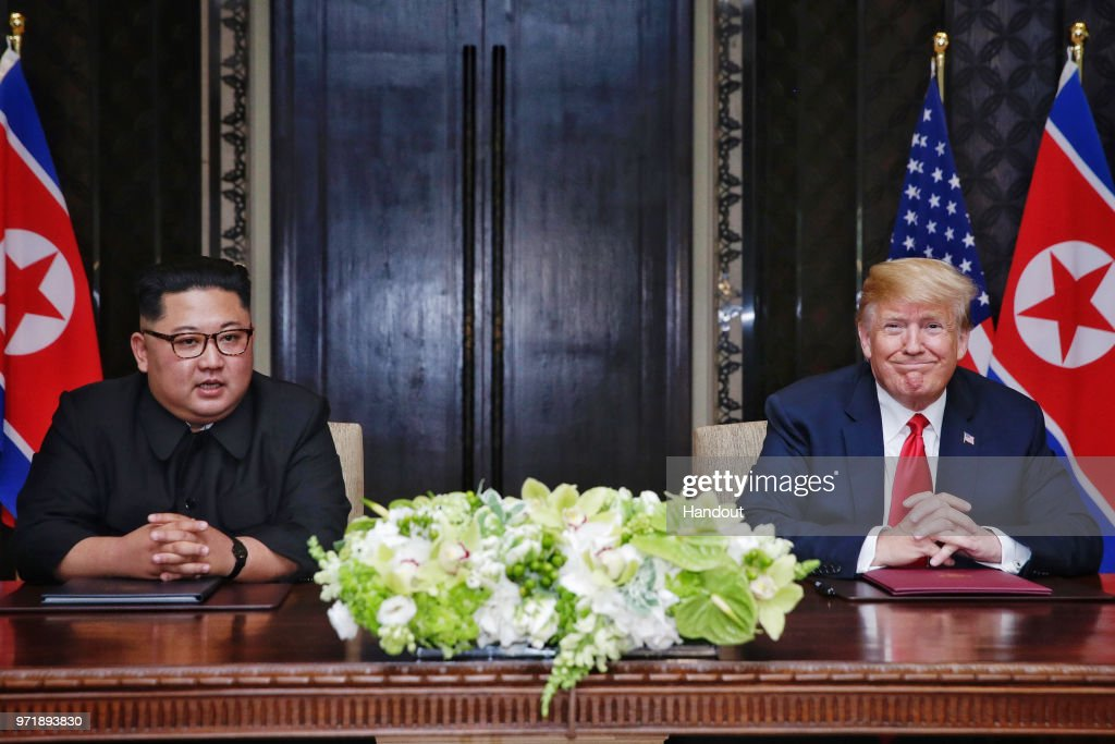 U.S. President Trump Meets North Korean Leader Kim Jong-un During Landmark Summit In Singapore : News Photo
