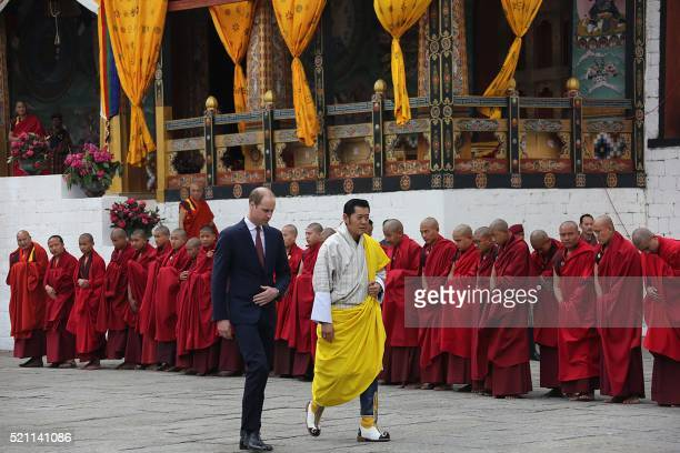 In this handout photograph released by the Royal Office for Media Bhutan on April 14 Britain's Prince William Duke of Cambridge walks with Bhutan's...