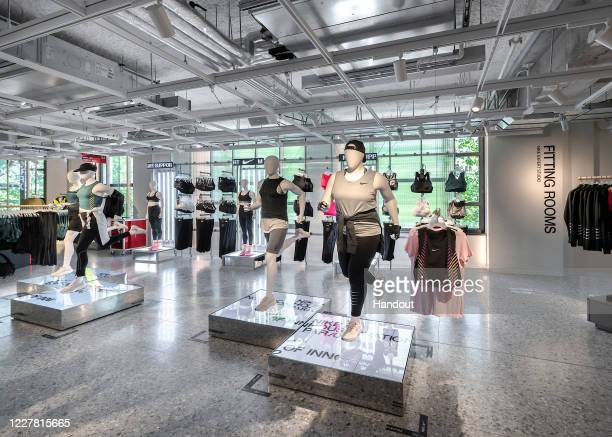 In this handout photograph supplied by Nike is a view of products for female athletes and all abilities mannequins on the second floor of Nike Paris...