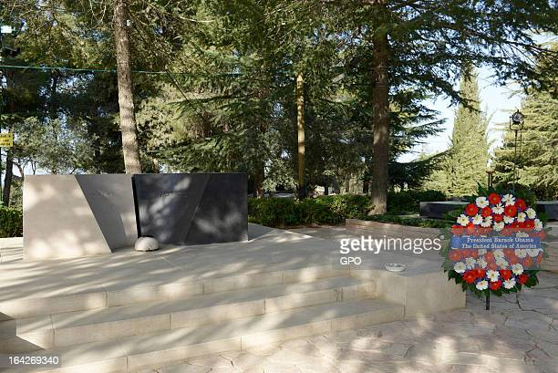 In this handout photograph supplied by the Government Press Office of Israel A wreath layed by US President Barack Obama is displayed at the grave of...