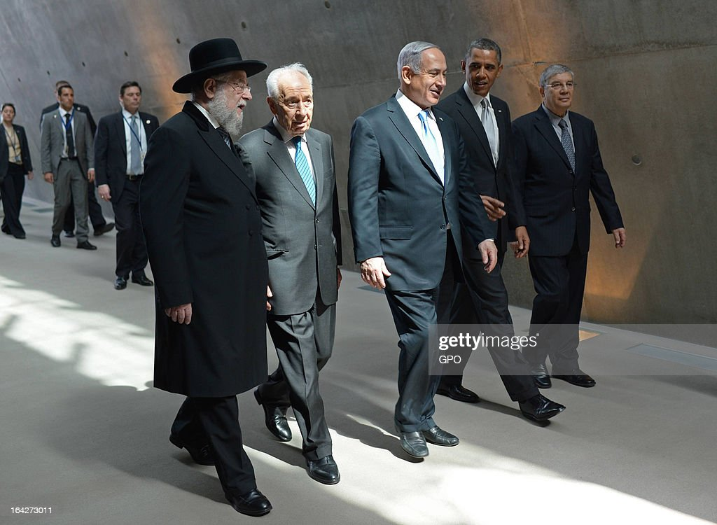 In this handout photograph supplied by the Government Press Office of Israel (GPO), U.S. President Barack Obama visits the Yad Vashem Holocaust Museum with (L-R) Rabbi Yisrael Meir Lau, Israel's President Shimon Peres, Israel's Prime Minster Benjamin Netanyahu and Chairman of the Yad Vashem Directorate Avner Shalev during a visit to Yad Vashem at Mount Herzl on March 22, 2013 in Jerusalem, Israel. This is Obama's first visit as president to the region and his itinerary includes meetings with the Palestinian and Israeli leaders as well as a visit to the Church of the Nativity in Bethlehem.