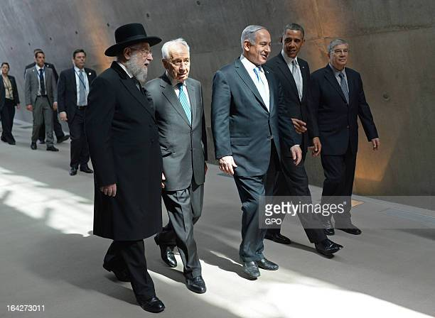 In this handout photograph supplied by the Government Press Office of Israel US President Barack Obama visits the Yad Vashem Holocaust Museum with...