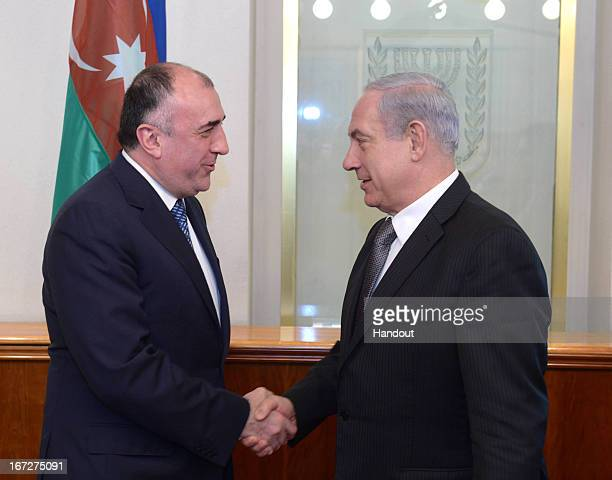 In this handout photograph supplied by the Government Press Office of Israel Israeli Prime Minister Benjamin Netanyahu meets with Azerbaijan Foreign...