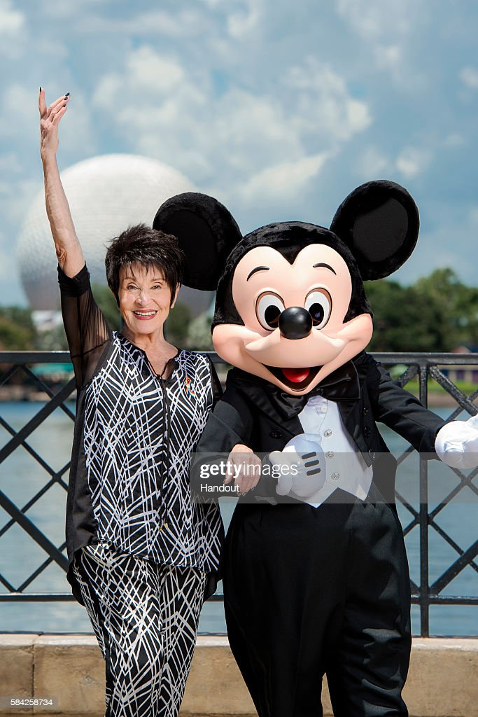In this handout photos provided by Disney Parks, Broadway legend Chita Rivera poses with Mickey Mouse July 27, 2016 at Epcot in Lake Buena Vista, Florida. Rivera stopped by a Disney Performing Arts musical theater workshop to meet with aspiring actors while vacationing at Walt Disney World Resort.